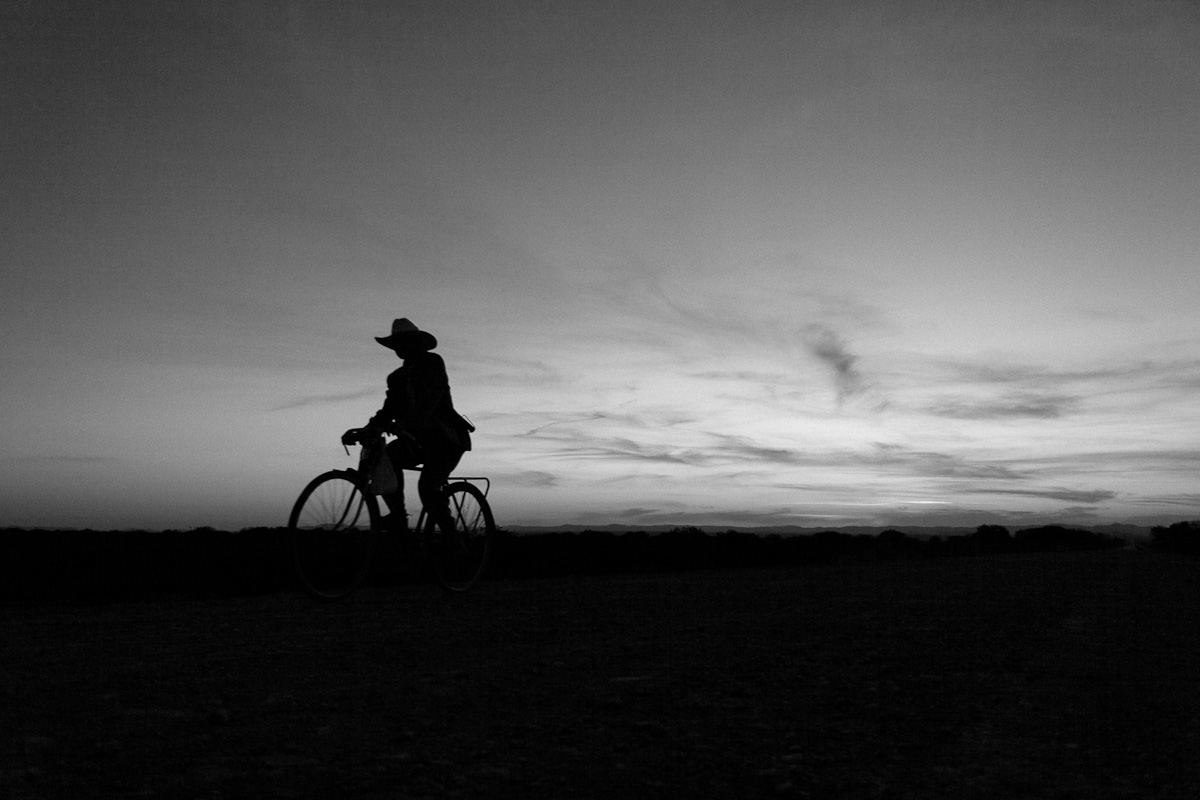 Man rides a bicycle from El Tecolote to the Estacion Catorce town where groceries and goods have to be bought due to the lack of access to the ranch.